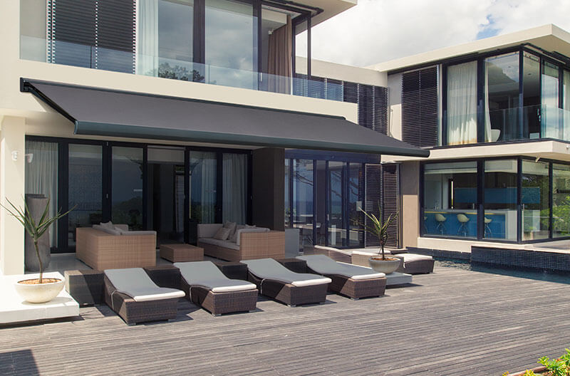 Luxaflex Folding Arm Awning over simple lounge and entertainment area
