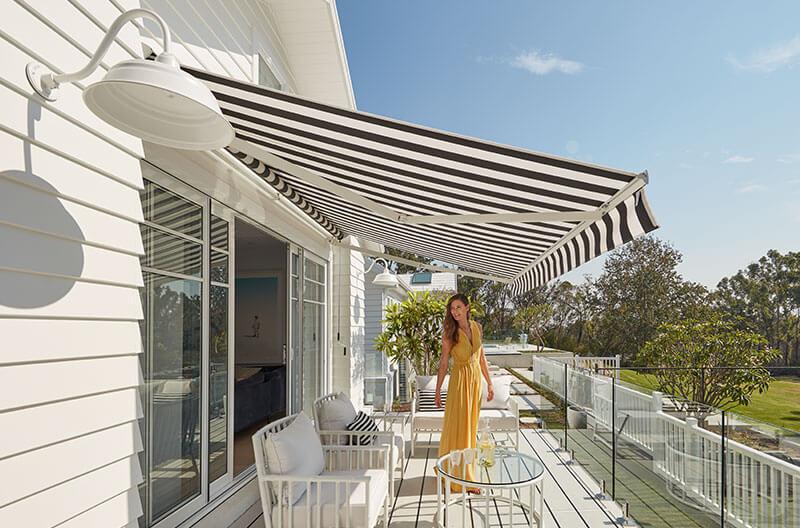 Luxaflex Folding Arm Awning over back deck, overlooking back lawn