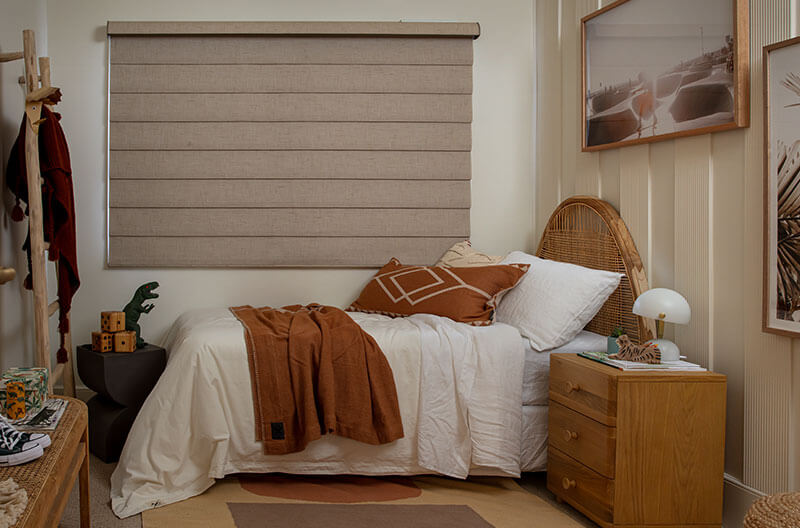Luxaflex Modern Roman Shades in Bedroom Setting. Blockout Fabric. Strong room darkening effect.