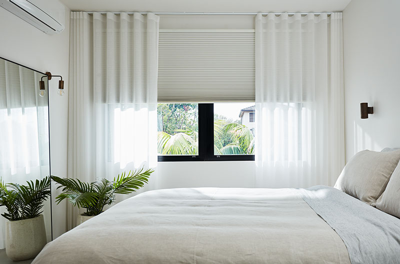 Luxaflex Curtains creating a soft touch to the bedroom.