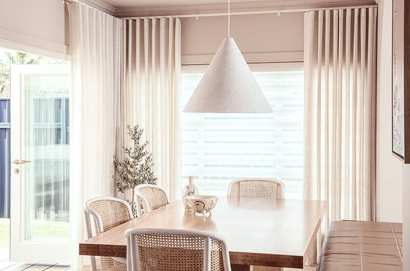 Luxaflex Pirouette Shadings paired with Luxaflex Curtains to have the ultimate in control over light, privacy and textures within the room.
