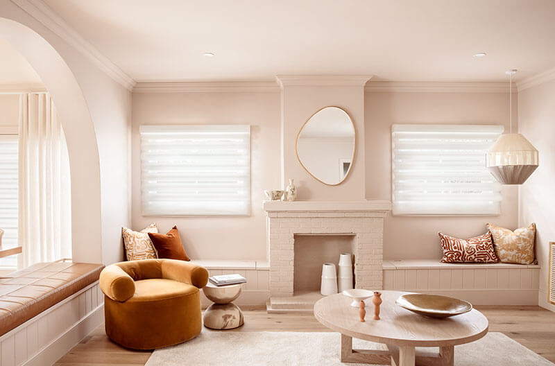 Luxaflex Pirouette Shadings in the lounge room creating a stylish and sophisticated atmosphere with a soft shutter look.