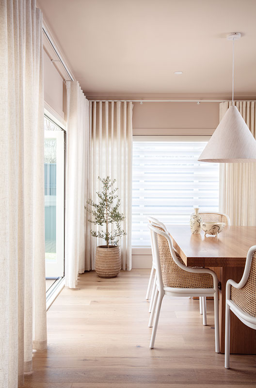 Luxaflex Curtains paired with Luxaflex Pirouette Shadings in the dining room