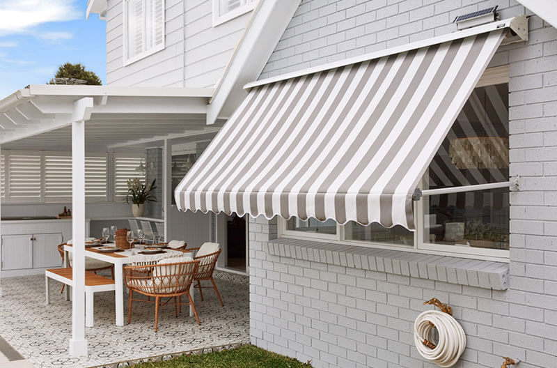 Luxaflex System 2000 awning off the back of kitchen in family backyard.
